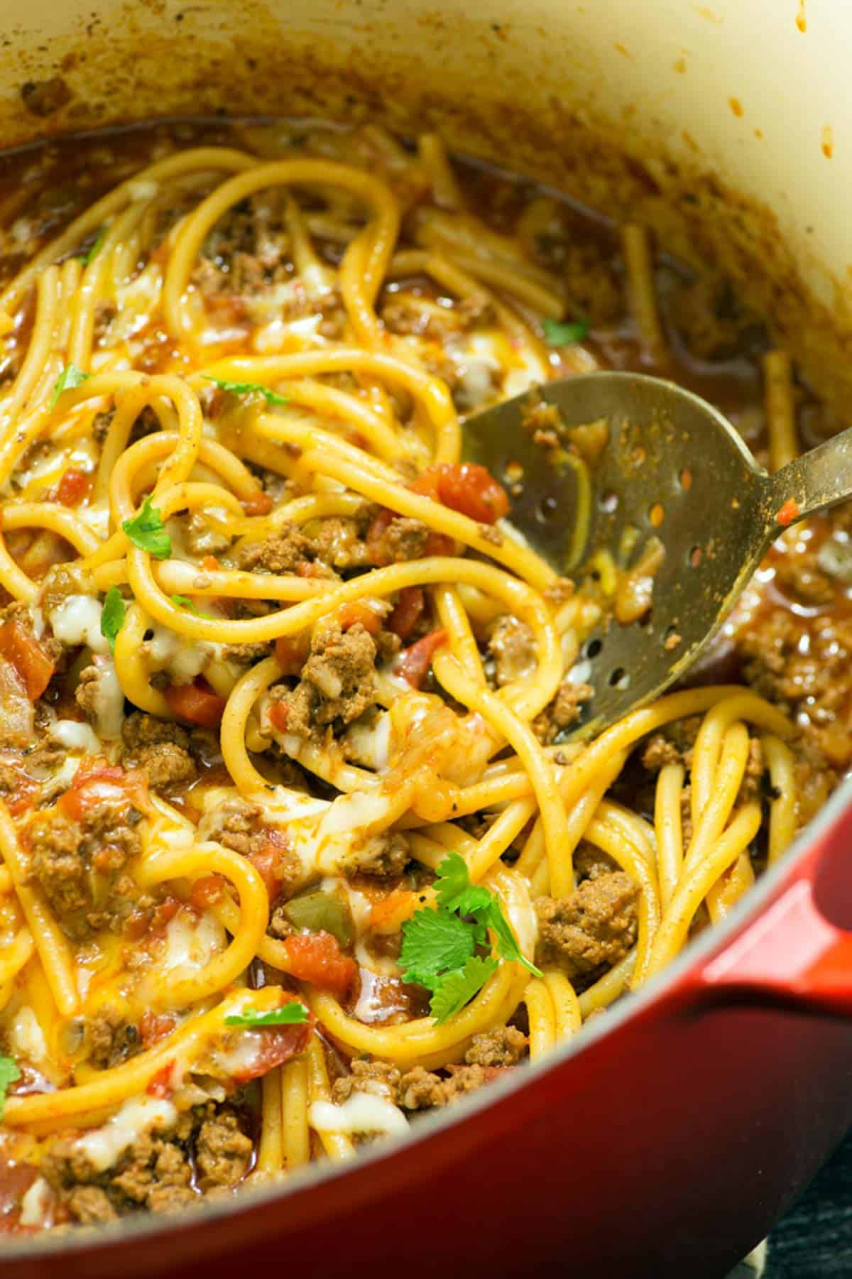 taco spaghetti casserole with a serving spoon