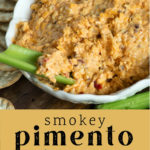 Smokey Pimento Cheese in a bowl with crackers and celery surrounding the bowl.