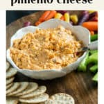 Smokey Pimento Cheese in a bowl surrounded by crackers.