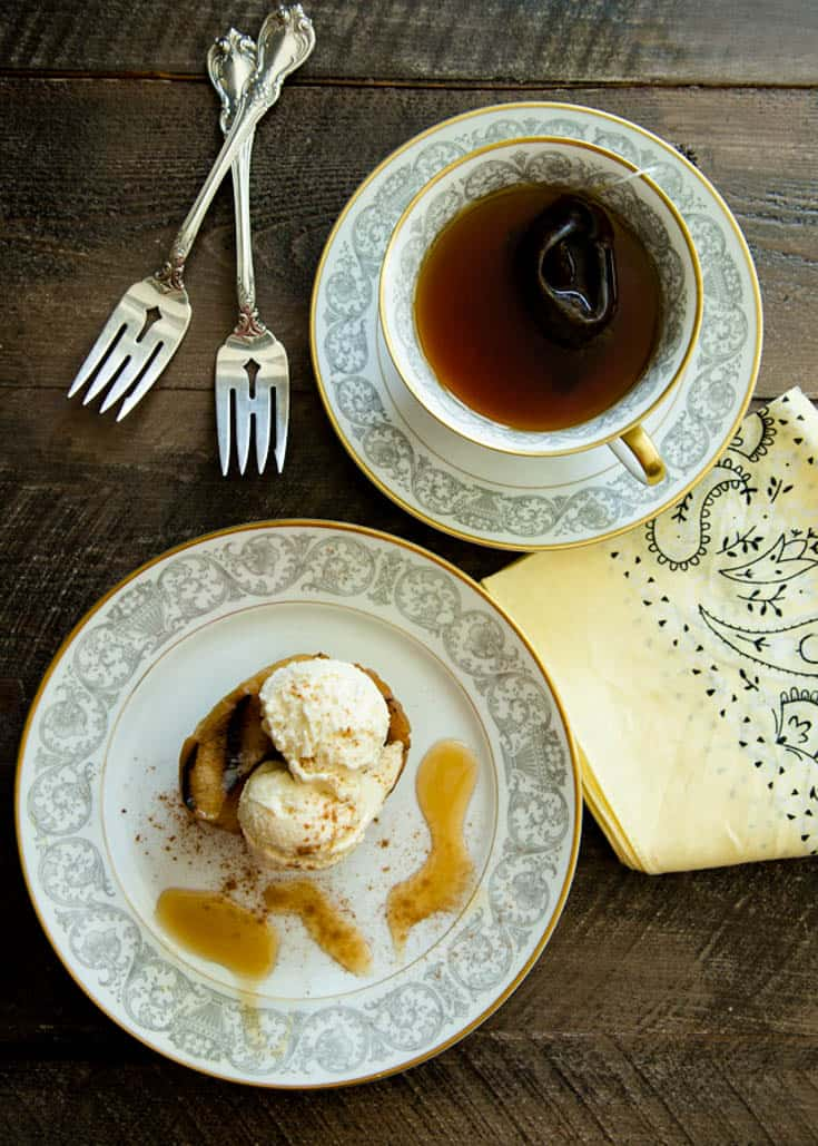 A grilled apple with ice cream and a cup of tea