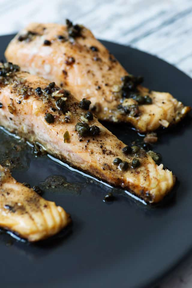 Salmon with Anchovy Butter on plate