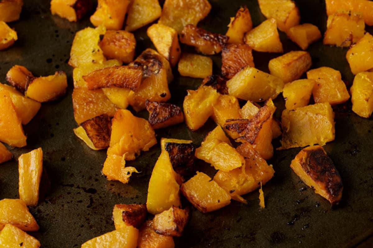 Roasted butternut squash on a baking pan.