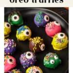 Halloween Oreo Truffles on a plate.