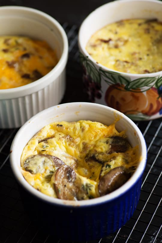 Baked Eggs with Mushrooms in white bowl