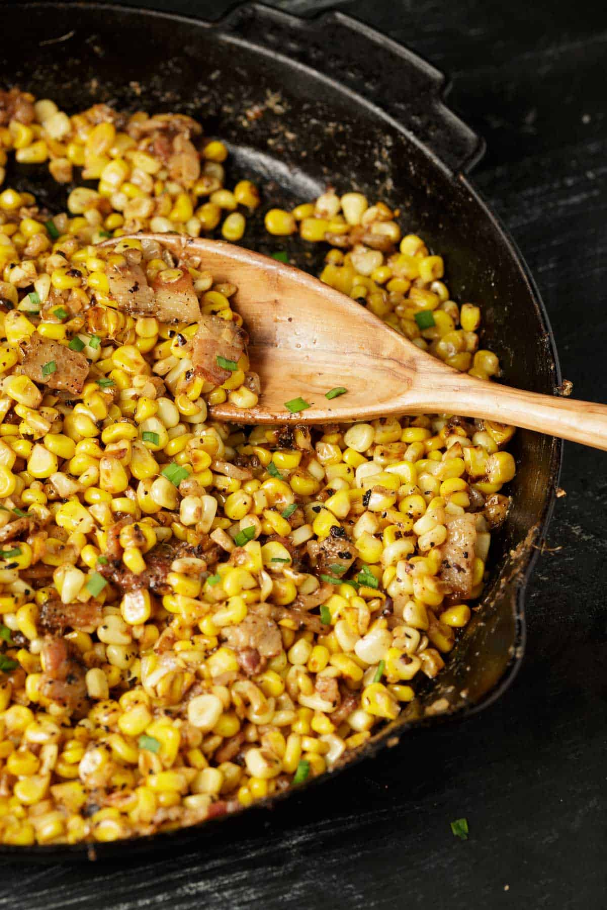 A skillet of corn and bacon.