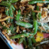 Green bean casserole with mushroom cream sauce in a casserole dish