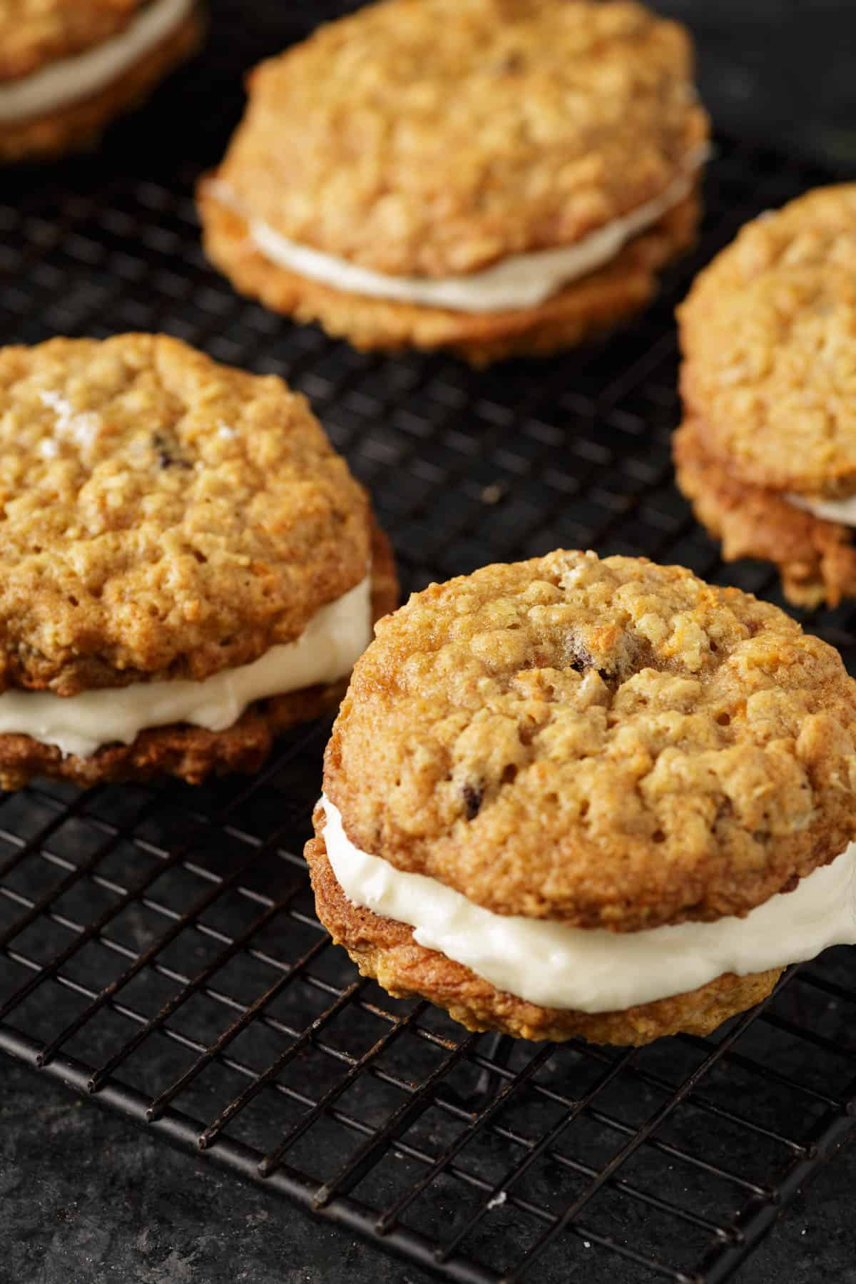 Carrot cake sandwich cookies on a cooling rack