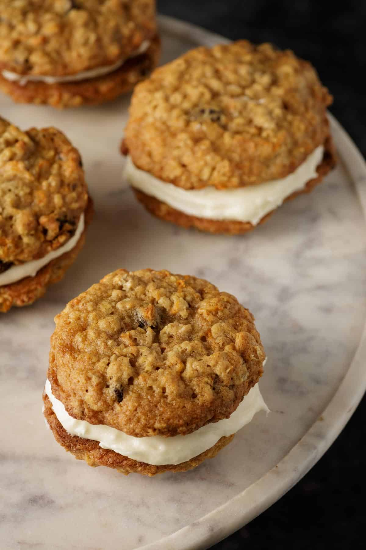 A marble platter with cream cheese filled carrot cake cookiees