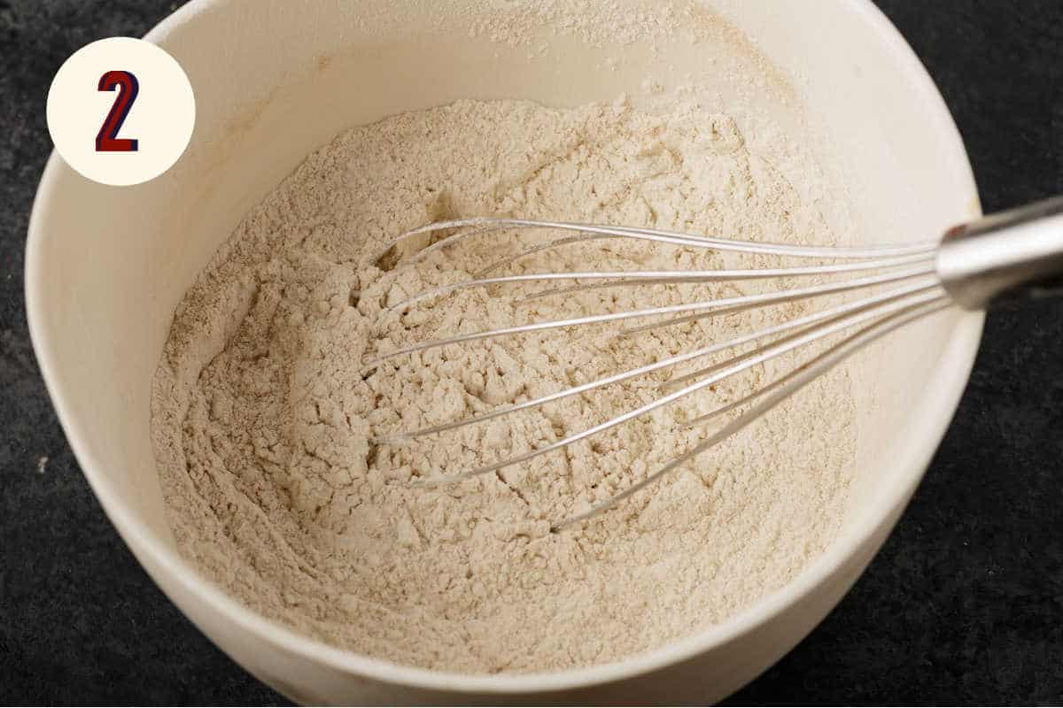 Dry ingredients for carrot cookies in a white bowl