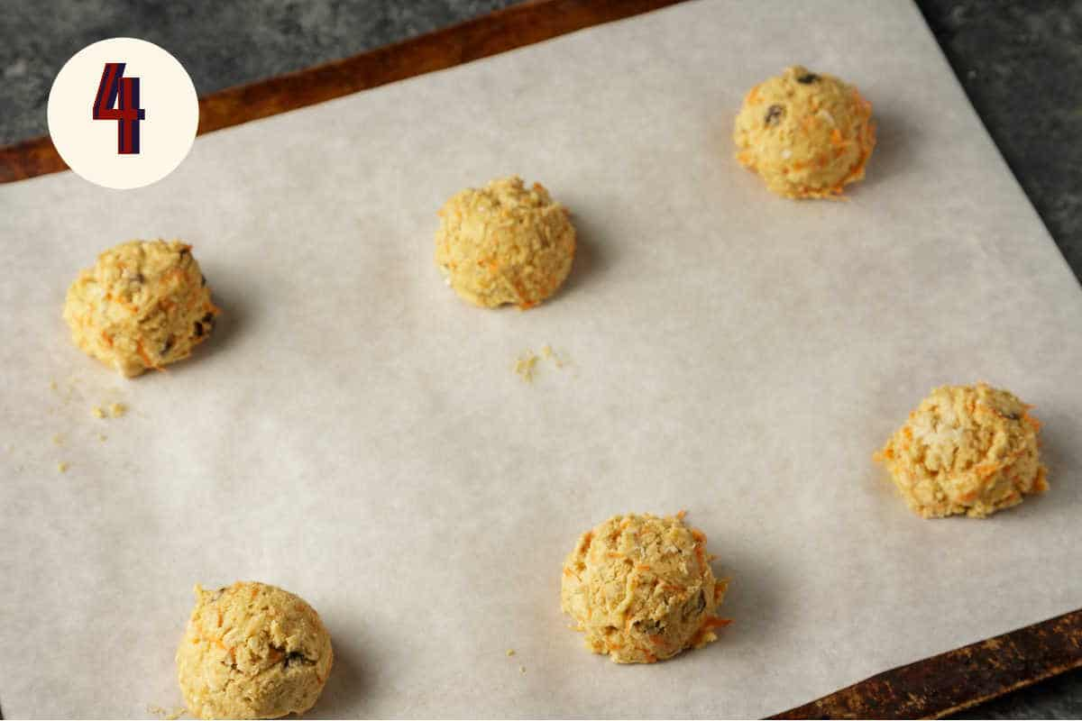 A baking sheet with cookie dough scoops