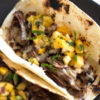With only 15 minutes of prep time, Slow Cooker Beef Tacos are perfect for a quick week night meal or if you need to feed a crowd. Full of flavor all by themselves but even better with pineapple mango salsa. |butterandbaggage.com