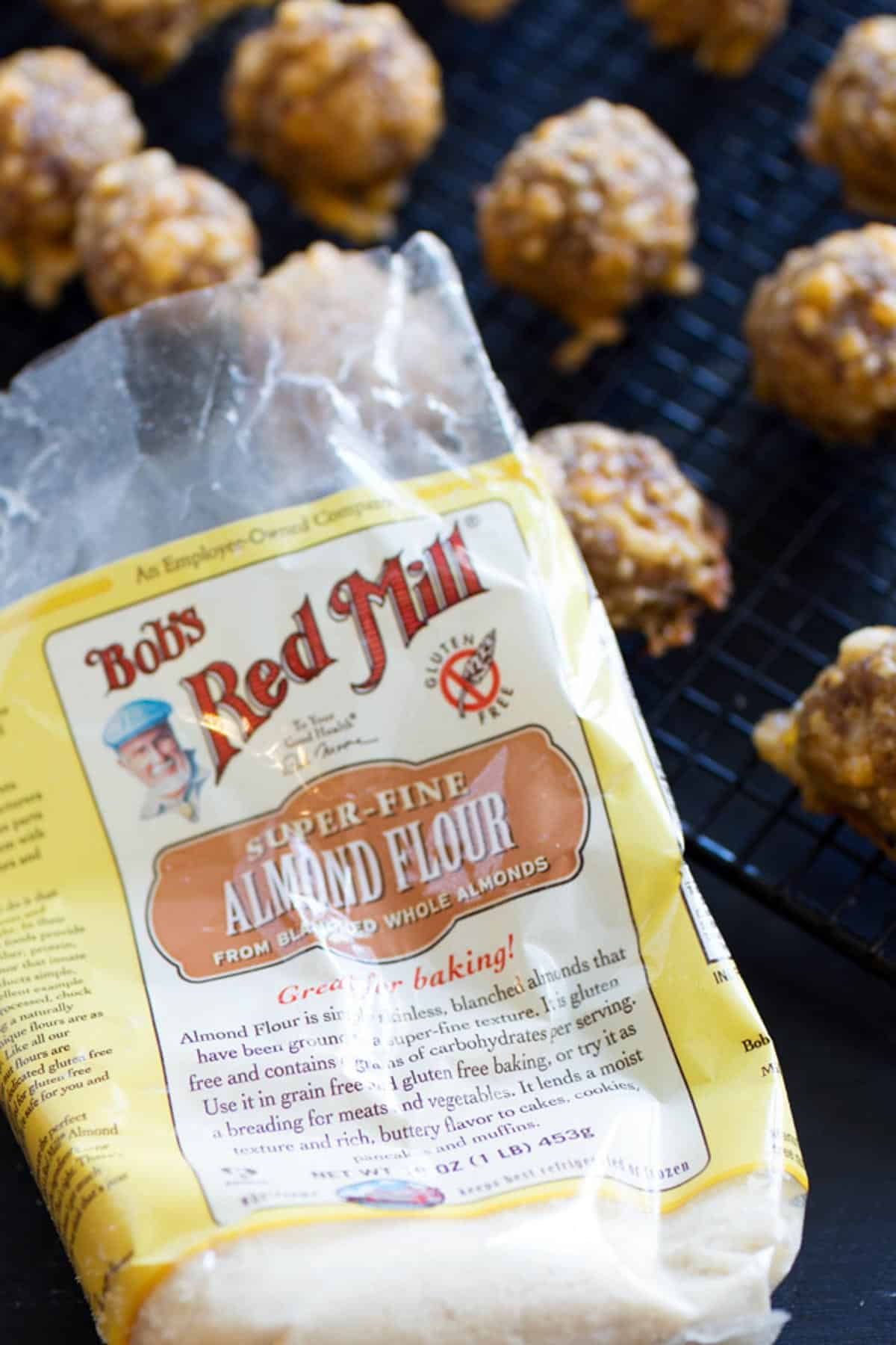 Sausage balls next to a bag of almond flour.