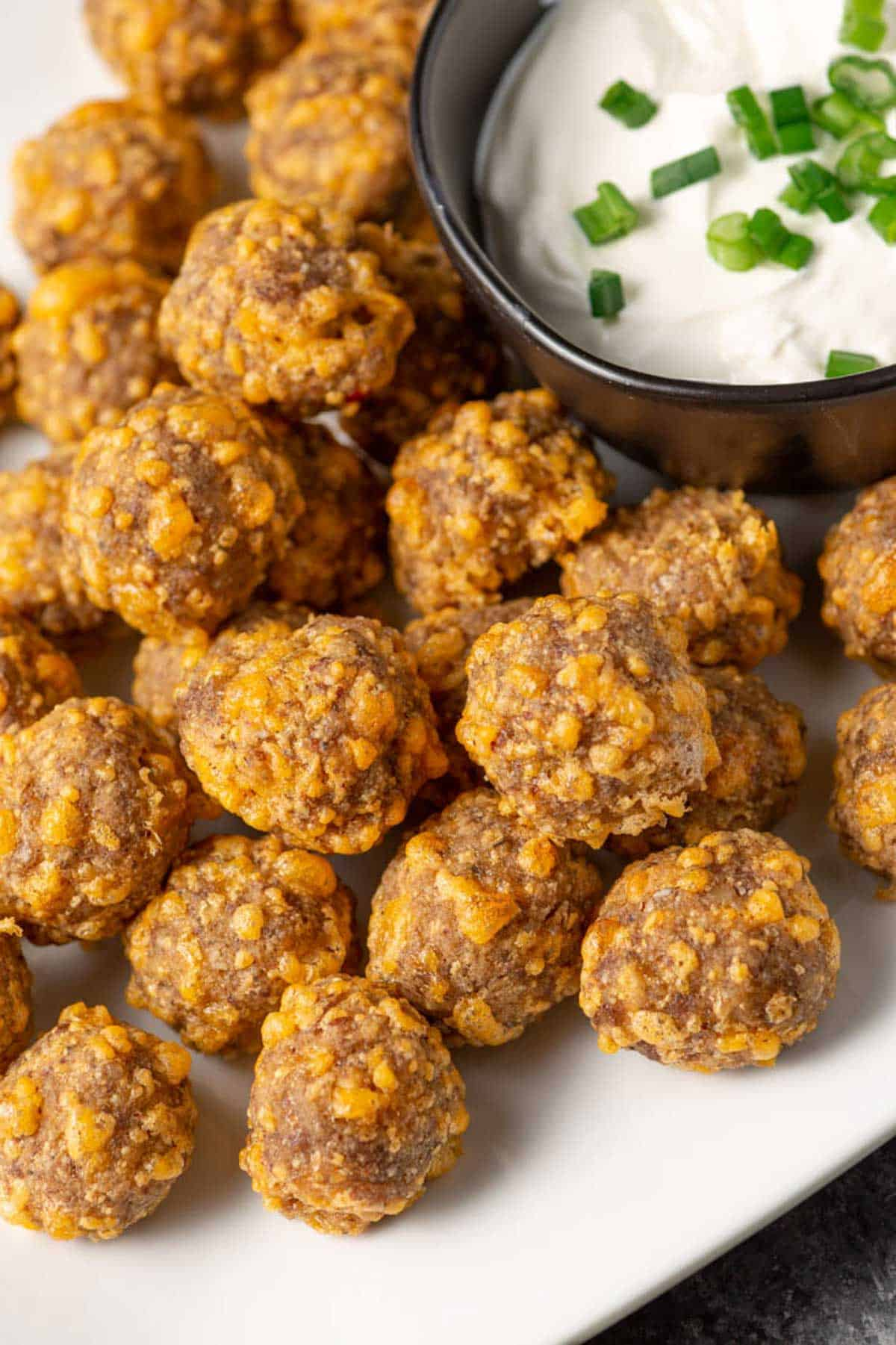 Low carb sausage balls on a serving tray.