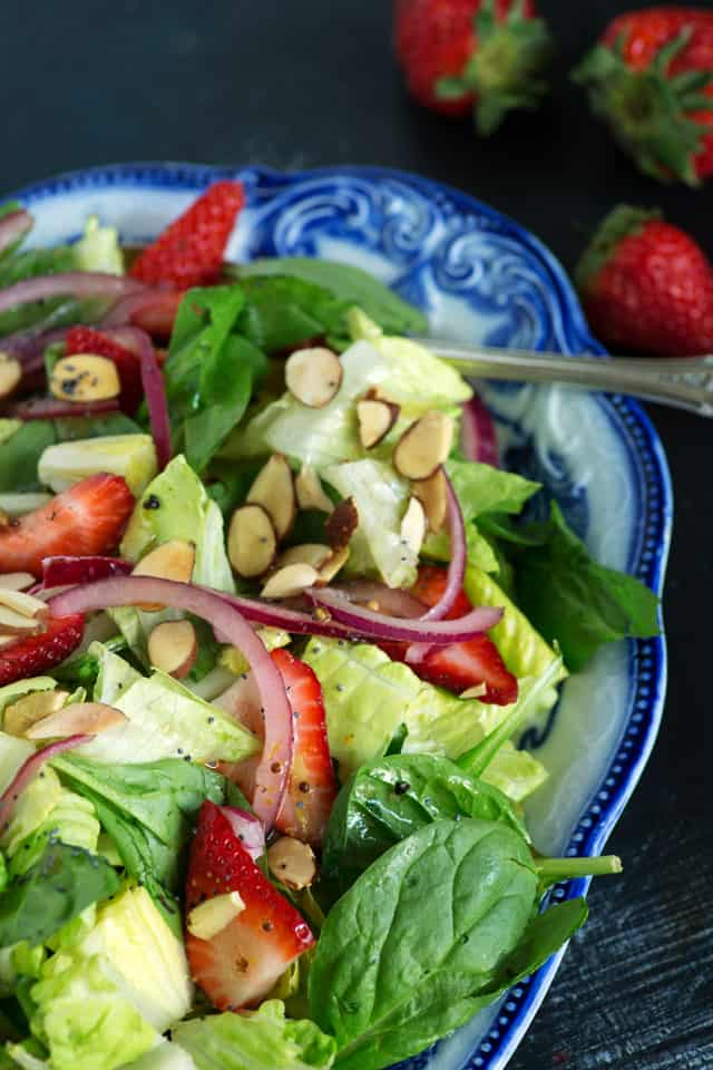 A platter of strawberry spinach salad