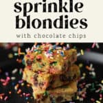 Three blondies with sprinkles falling on them