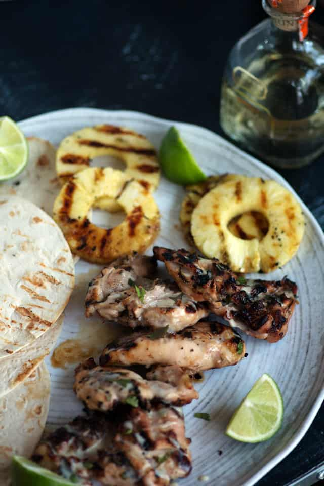 Tequila Grilled Chicken on plate with pineapple and limes