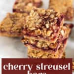Cherry Streusel Bars stacked on top of each other.