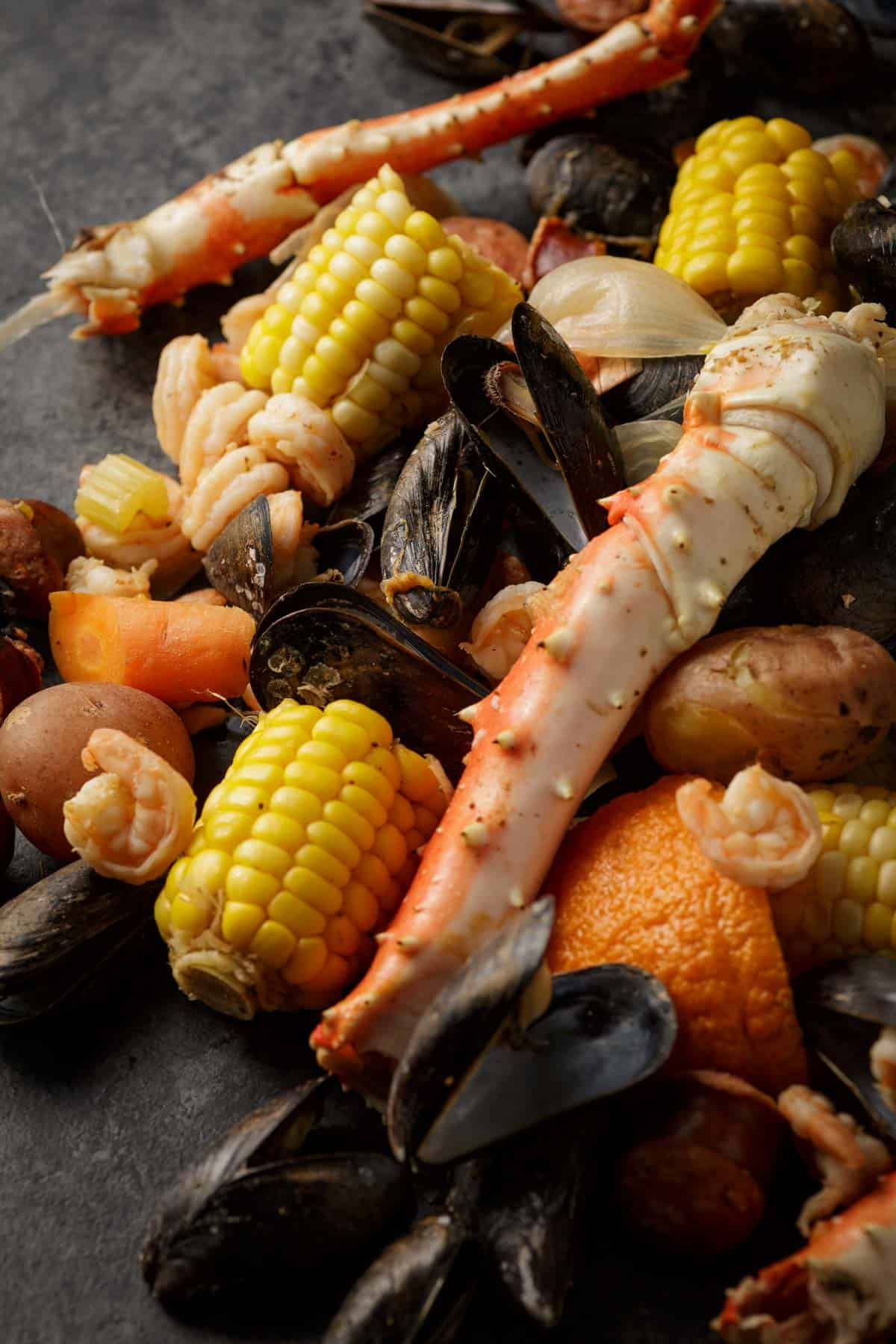 A seafood boil poured out onto a black board