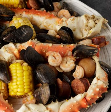 A white platter full of seafood