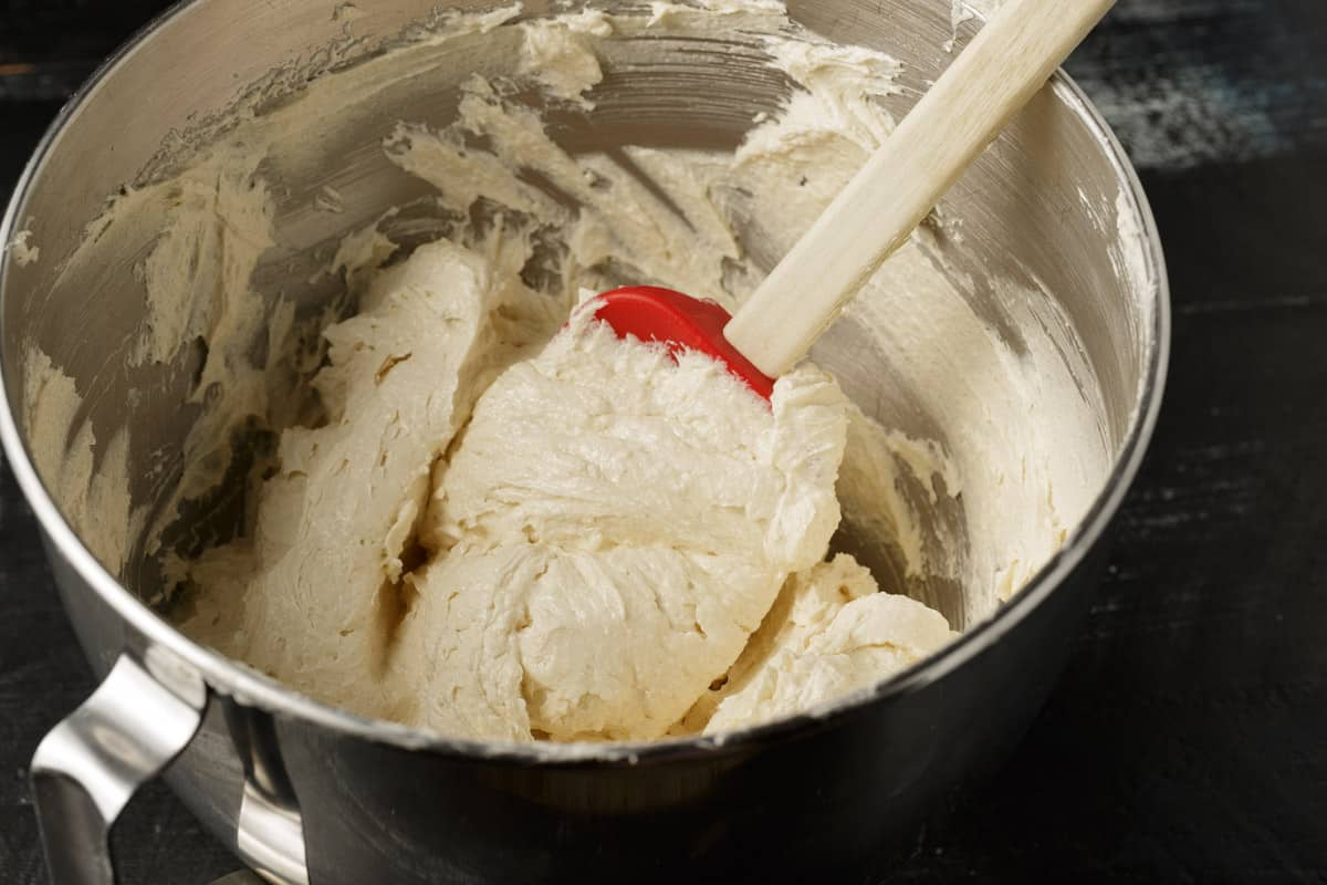 Butter and sugar creamed together in a mixing bowl.