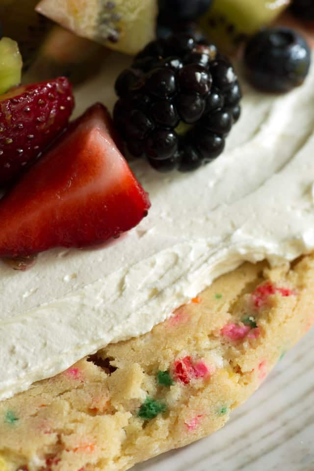A sprinkle cookie crust with fruit and cream cheese on top