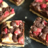 Dark Chocolate Raspberry Bars have a rich fudgy layer over buttery shortbread and of course raspberries and more chocolate on top. You're going to Love this simple recipe. |butterandbaggage.com