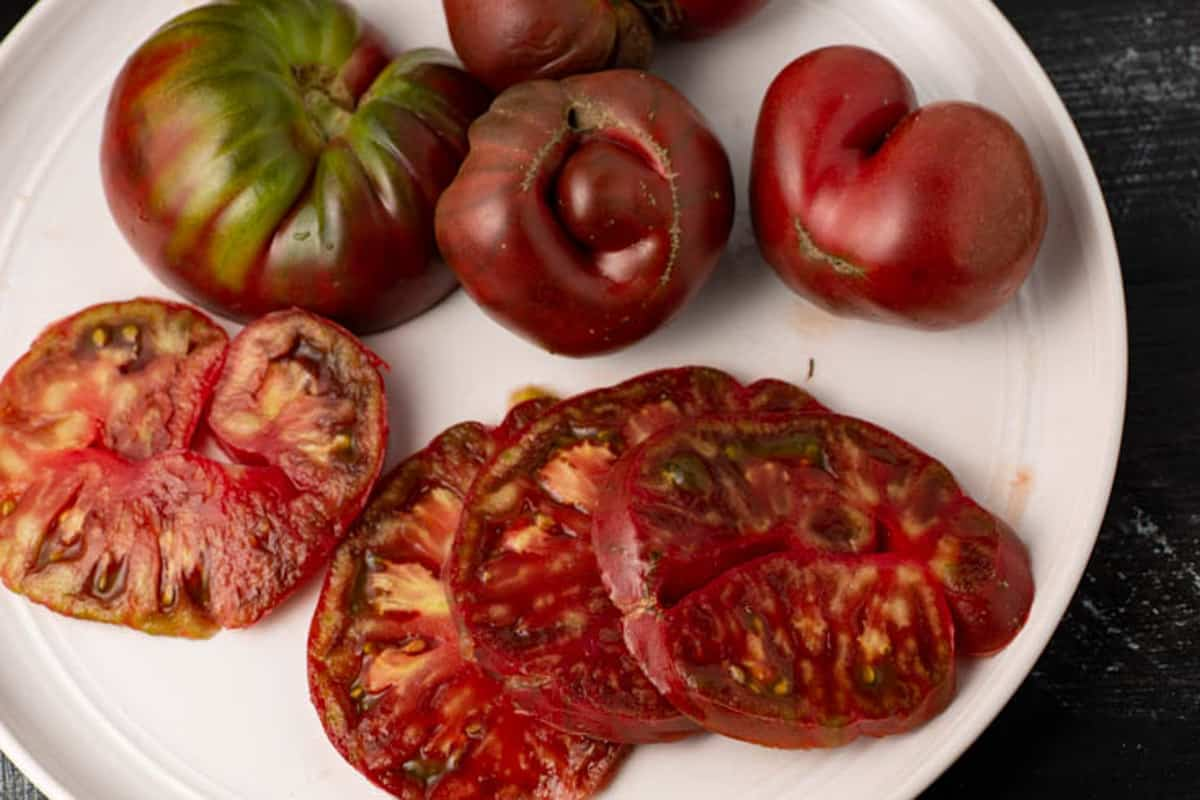 Sliced heirloom tomatoes on a plate