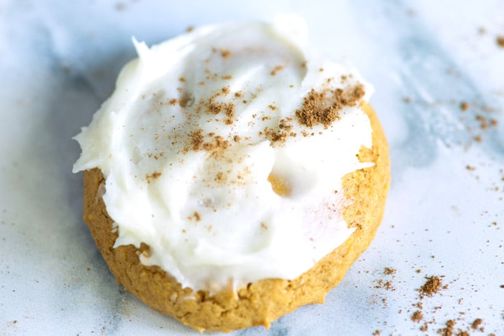 A soft melt-in-your-mouth pumpkin cookie covered in cream cheese frosting that's EASY to make and will remind you of fall, whatever the season. Add a little pumpkin spice to the frosting for that fabulous pumpkin pie flavor. |butterandbaggage.com