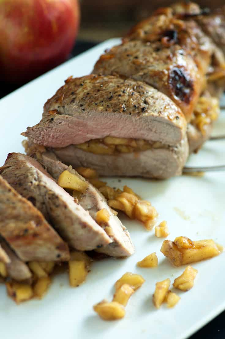 Pork tenderloin sliced on marble board