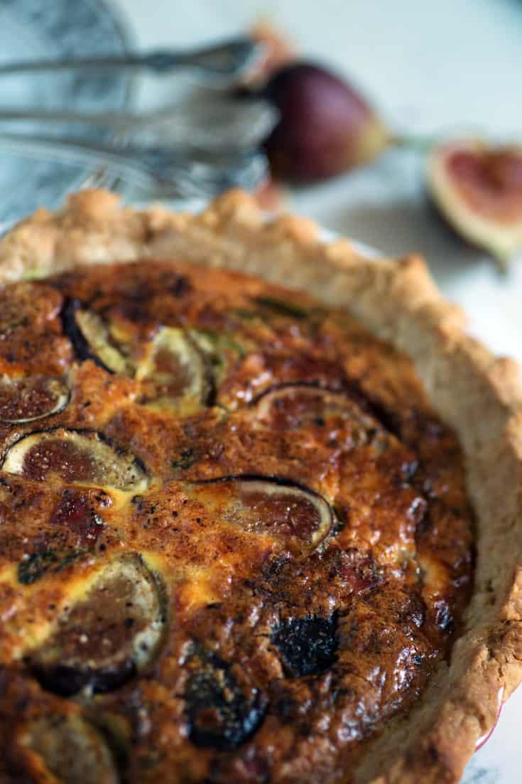 Quiche with figs and prosciutto in dish