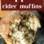 An Apple Cider Muffin with a bite taken out of it.