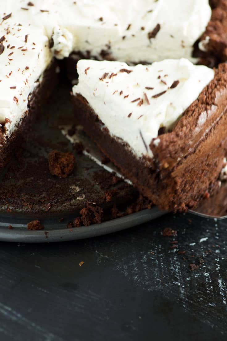 Slice of Flourless chocolate cake on baking dish with forks