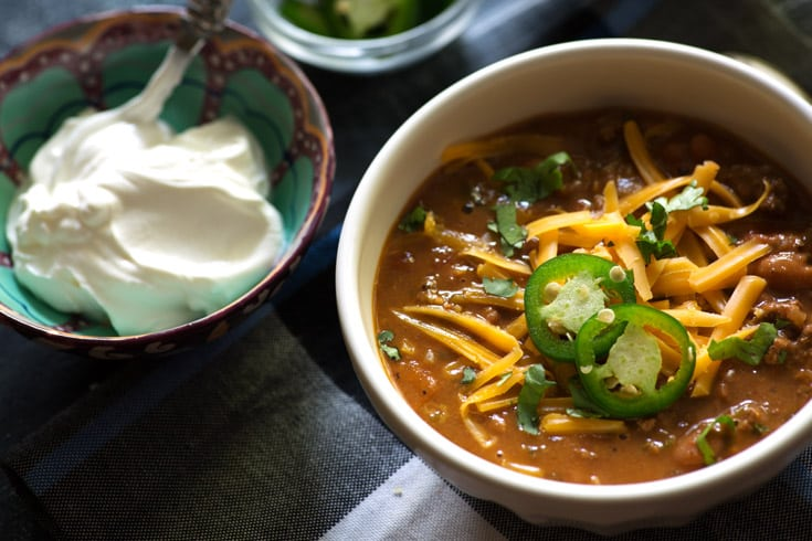 Creating chili in the Instant Pot allows you great flavors in just 1 hour. You can enjoy this version or use your favorite recipe. It's so good, you may never go back to the slow cooker. |butterandbaggage.com