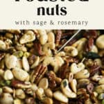 Roasted Nuts with Sage and Rosemary being scooped out.