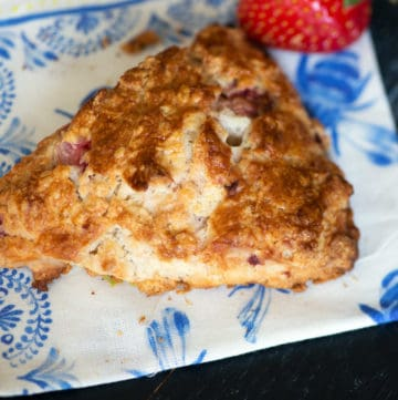 A strawberry scone on a napkin