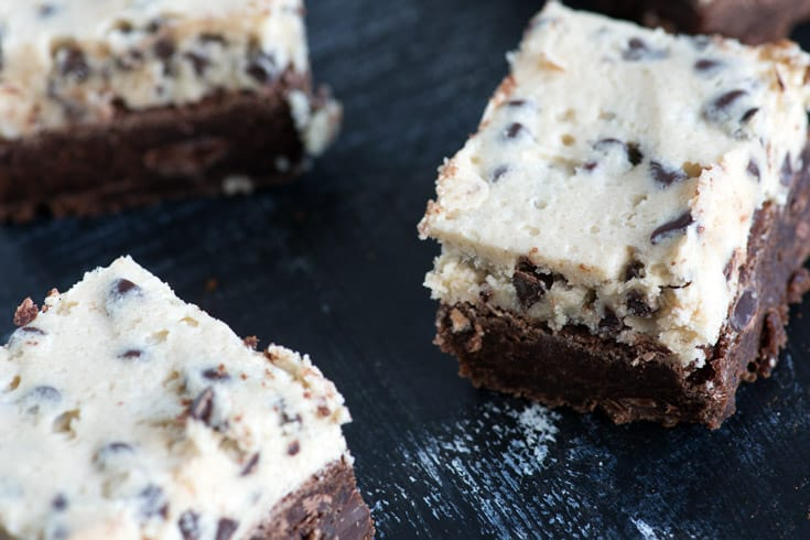 Cookie dough brownies cut into squares on black table