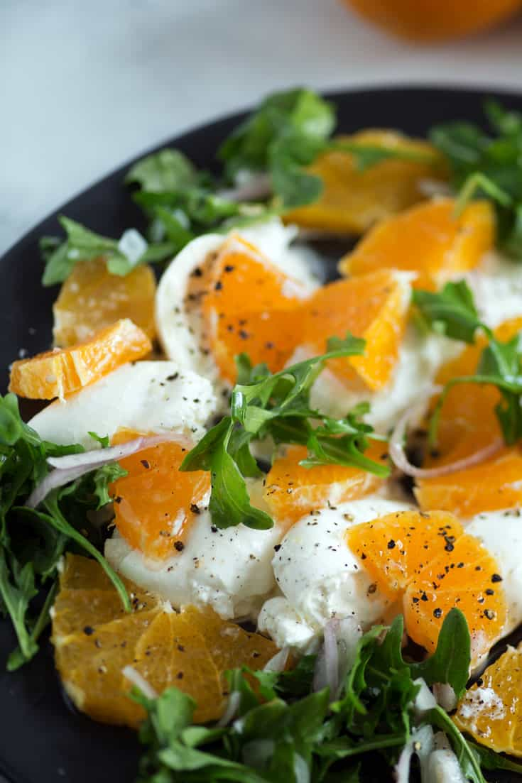 A plate of burrata and orange slices