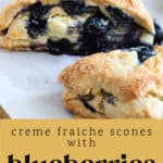 Two Creme Fraiche Scones with Blueberries on a plate.