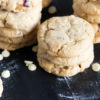 Cookies on a board with white chocolate chips