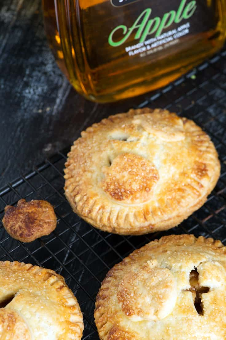 Apple Hand Pies with a bottle of apple brandy