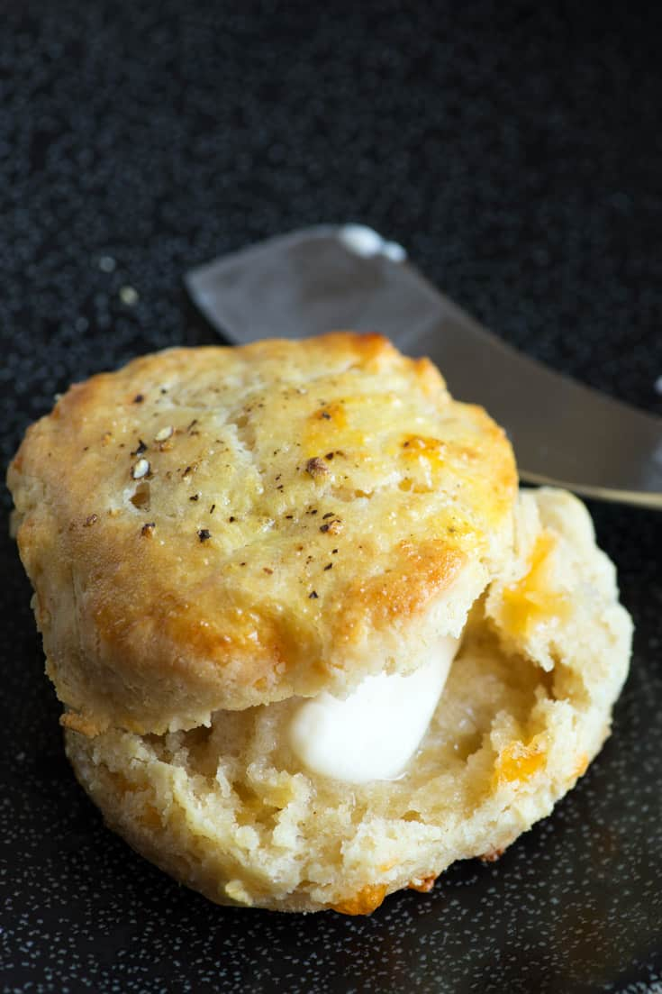 A gluten free biscuit with butter