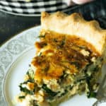 A slice of quiche with caramelized onions