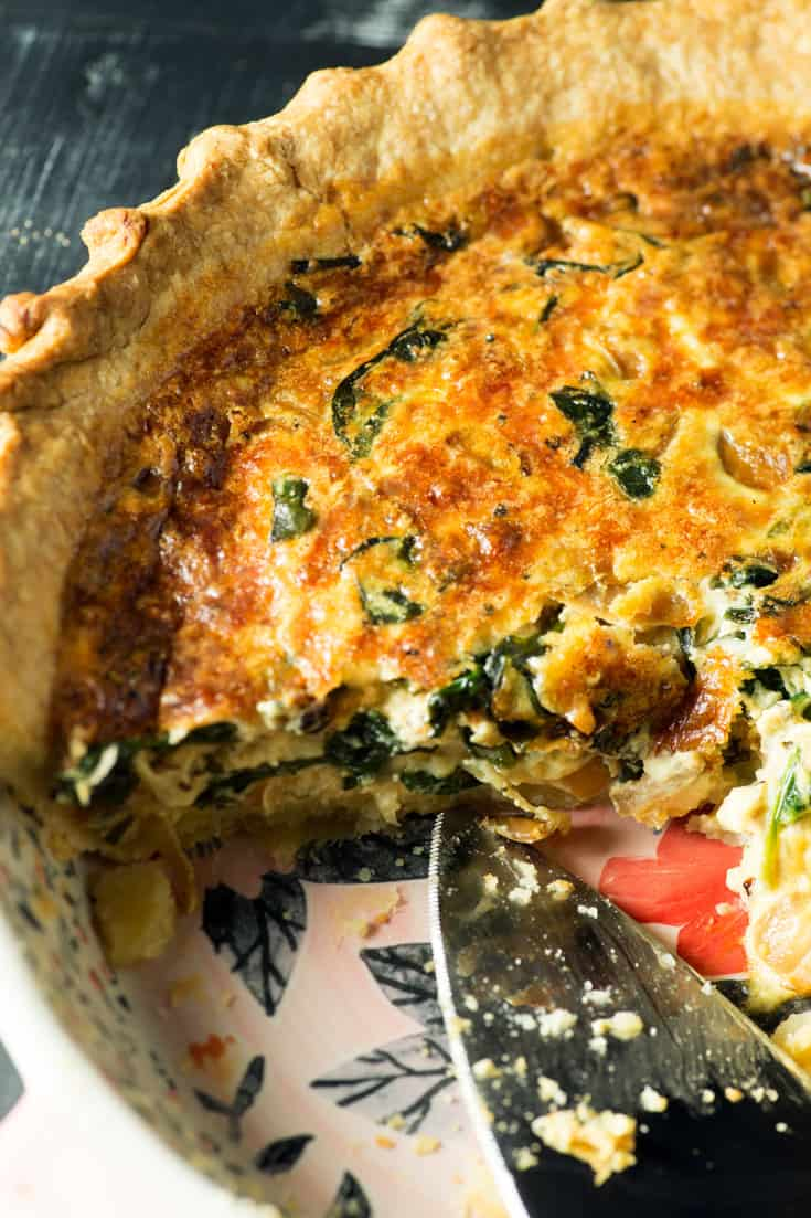 Quiche with caramelized onions in a pie dish