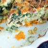 A slice of quiche with sweet potato crust