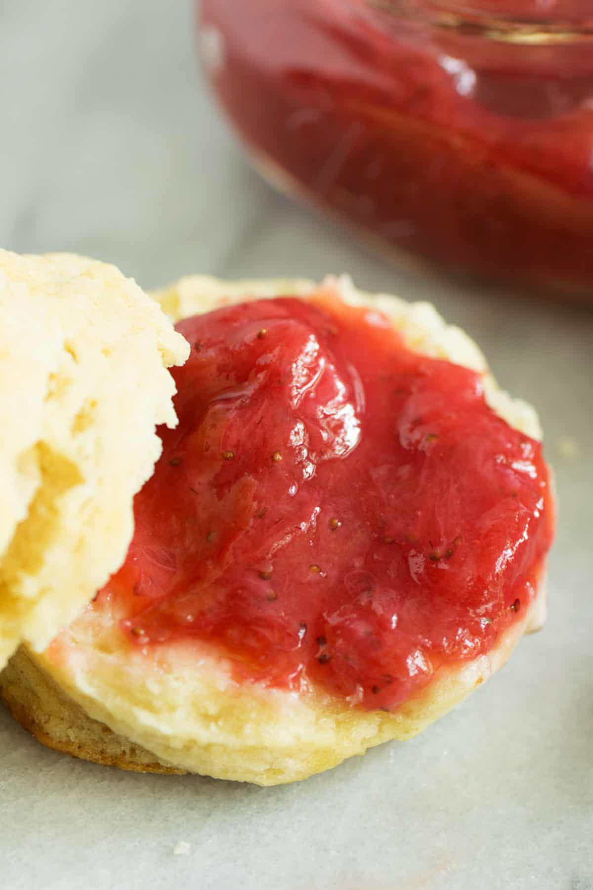 A biscuit with strawberry rhubarb jam