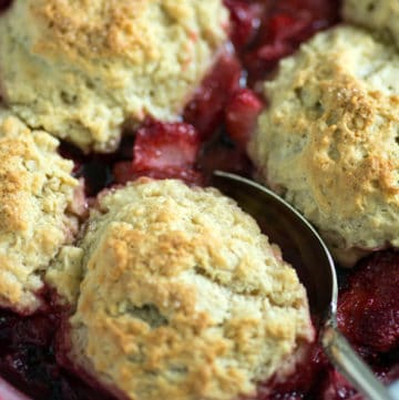 A serving dish of strawberry cobbler