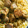 A platter of Chicken Marsala Meatballs over egg noodles