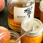 A jar of Peach Vanilla Jam with Hibiki in the background