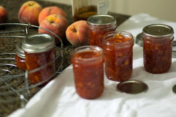 Peach Vanilla Jam being put into canning jars