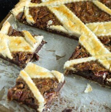 A pecan slab pie cut into squares.